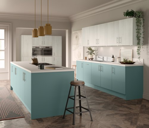 Light blue hacienda kitchen with base units and island , and light grey woodgrain on wall units. wooden floor