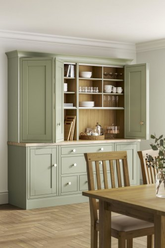 A pale green laura ashley whitby kitchen with wooden floor and wooden worktops