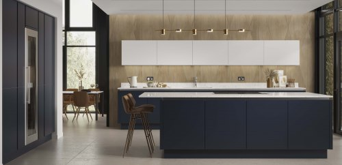 Indigo kitchen on island and a bank of tall units to the left, with white wall units on a wood effect wall with brown accessories.