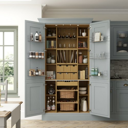 a pale blue kitchen with a classic kitchen pantry within it. A selection of kitchenware is shown within the pantry