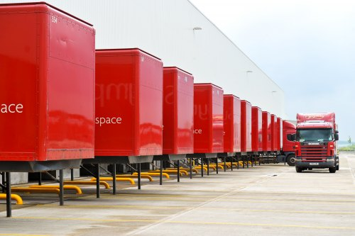 a row of red symphony lorries at the Barnsley manufacturing